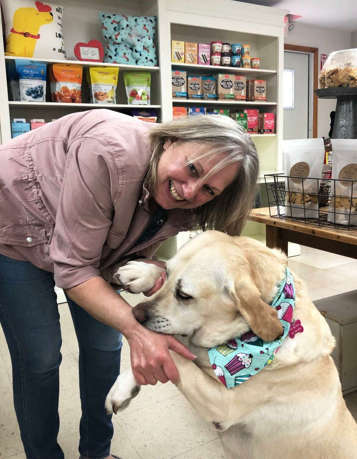 Spectrum/Debbie Bauman, owner of The Barkery Boo'tique in New Milford has moved the business from Bank Street to 92 Park Lane Road (Route 202). Bauman is shown above with her dog, Daisy, an 8-year-old Yellow Lab, who is the store's