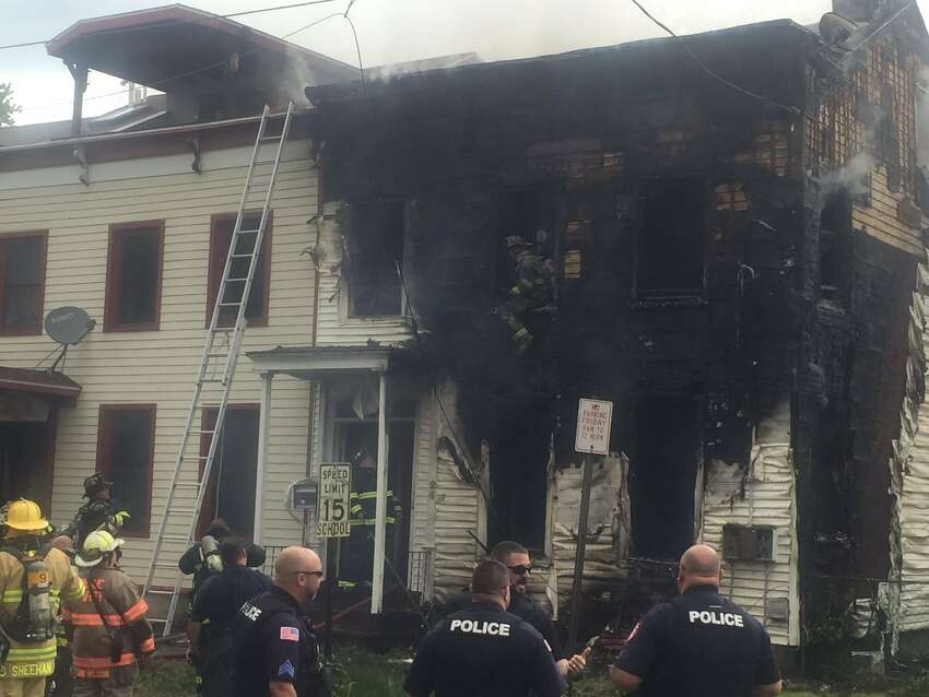 Fire gutted 24 Broadway, Rensselaer, and appeared to spread into at least one neighboring building Tuesday morning.
