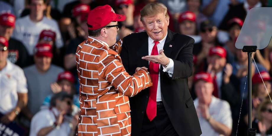Donald Trump, right, brings Blake Marnell on stage during a campaign rally in Montoursville. May 20, 2019. Photo: AP