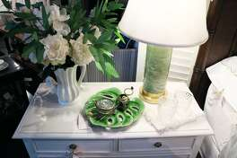 Adding a few simple design elements like a tropical tray, faux floral bunch and a fresh linen napkin can take your side table from functional to fun. (Hadnout/TNS)