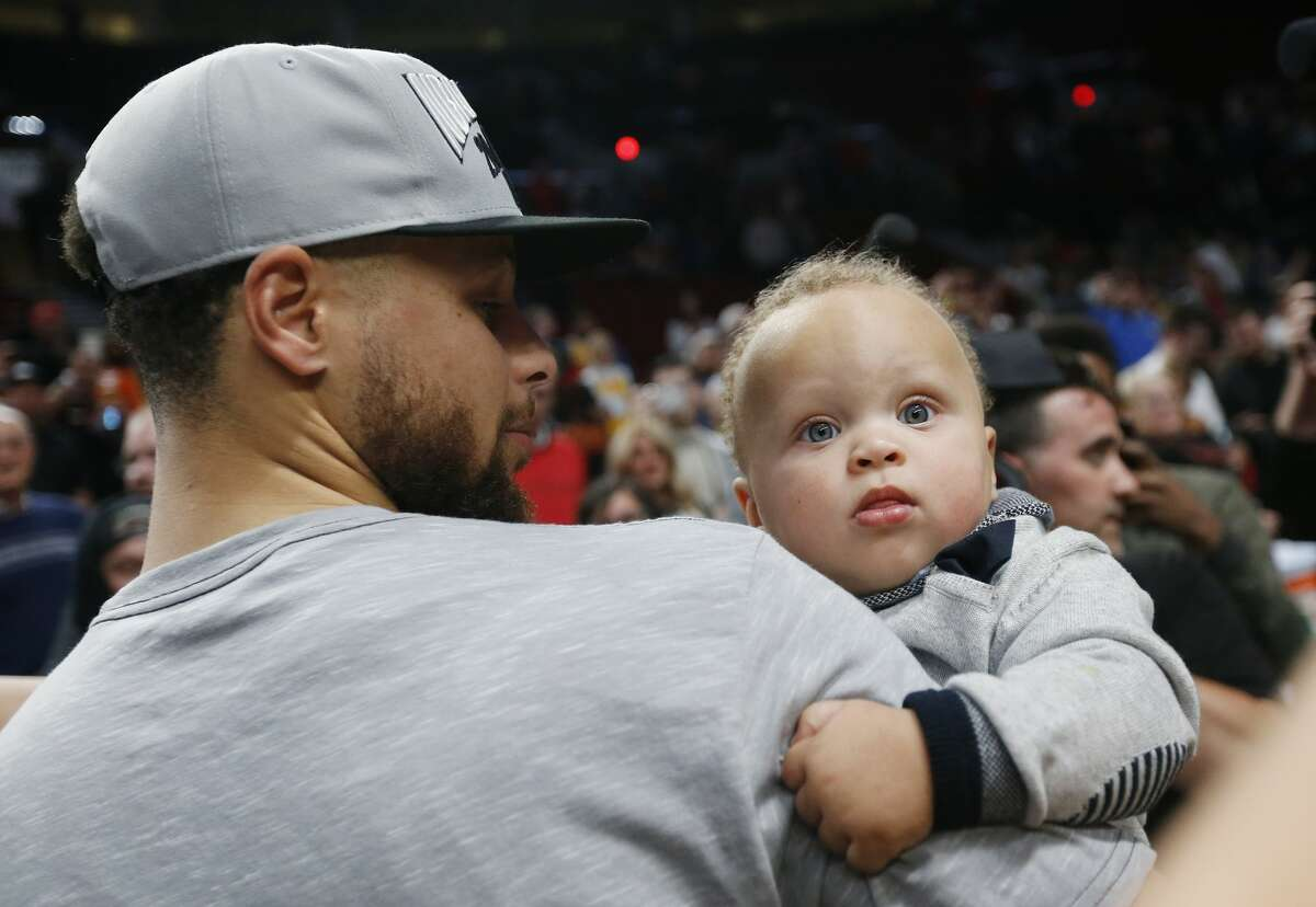 Stephen Curry holds his son Canon after defeating the Portland Trail Blazers 119-117 during overtime in game four of the NBA Western Conference Finals on May 20, 2019 in Portland.
