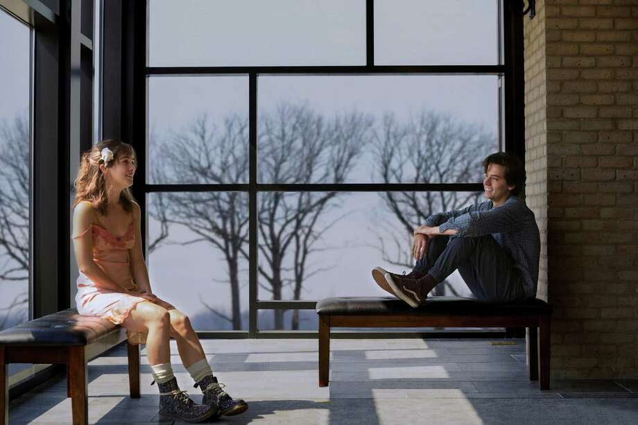 "Haley Lu Richardson and Cole Sprouse keep their distance, for now, in ""Five Feet Apart."" Photo: Patti Perret / CBS Films"