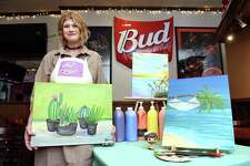Jen Beckwith, owner of Jen's Creative Painting, at in the Orange Ale House in Orange on May 4, 2019 where she hosts painting parties.