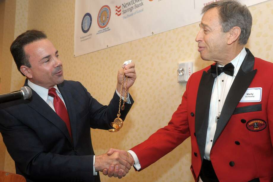 Mayor Joe Ganim presents P.T. Barnum's gold watch to 2019 Barnum Festival Ringmaster Marty Schwartz during the annual Whip, Whistle & Watch luncheon in Bridgeport, Conn. May 17, 2019. Schwartz, who recently retired as President and CEO of the Kennedy Center, is the 71st Barnum Festival Ringmaster. Photo: Ned Gerard / Hearst Connecticut Media / Connecticut Post