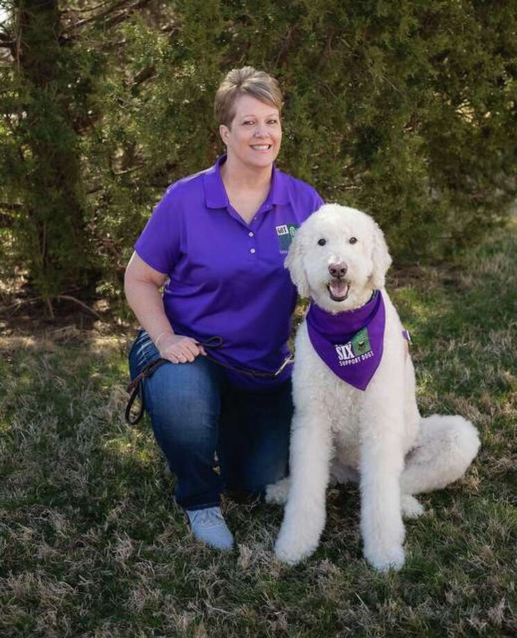 Therapy dog Izzy and handler Kelly Photo: Courtesy Of Got Your Six Support Dogs