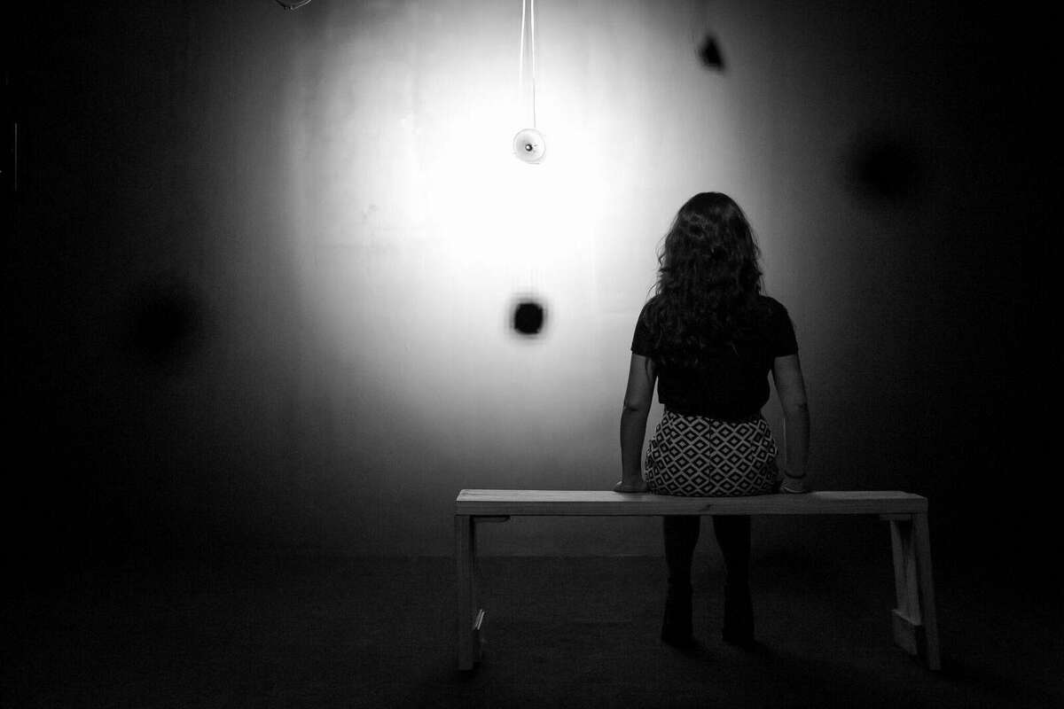 """Artist Lina Dib poses within her sound installation """"North to South and Back,"""" which is up through June 9 at Space HL."""