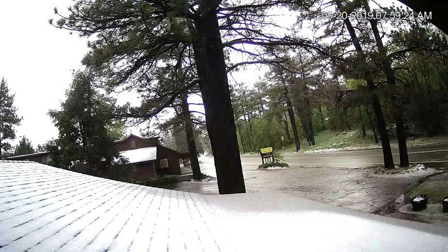An image from the Laguna Mountain Lodge webcam showing snow in the mountains behind San Diego on May 20, 2019. Photo: Laguna Mountain Lodge