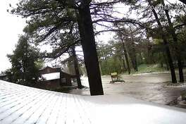 An image from the Laguna Mountain Lodge webcam showing snow in the mountains behind San Diego on May 20, 2019.