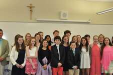 New inductees into the National Junior Honor Society at St. Thomas School.