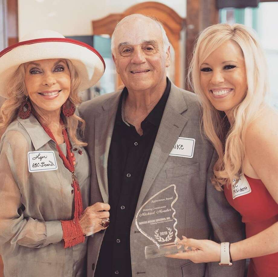 From left, Lyn Howard, ABC Inc. board member, honoree Montgomery County Precinct 1 Commissioner Mike Meador and ABC Inc. Board President Rebecca Smith. Meador was honored on May 16 at an Access Builds Children, Inc. fundraiser for his contributions to the group. Photo: Photo Courtesy Lynn Howard