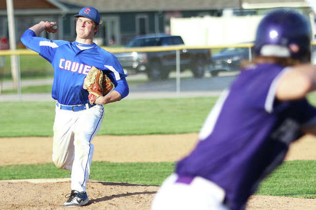 Carlinville pitcher Colton DeLong delivers during a game at Litchfield on April 16. DeLong and the entire Cavs pitching staff will be available for Wednesday's semifinal against the host Cardinals at the Pleasant Plains Class 2A Sectional.
