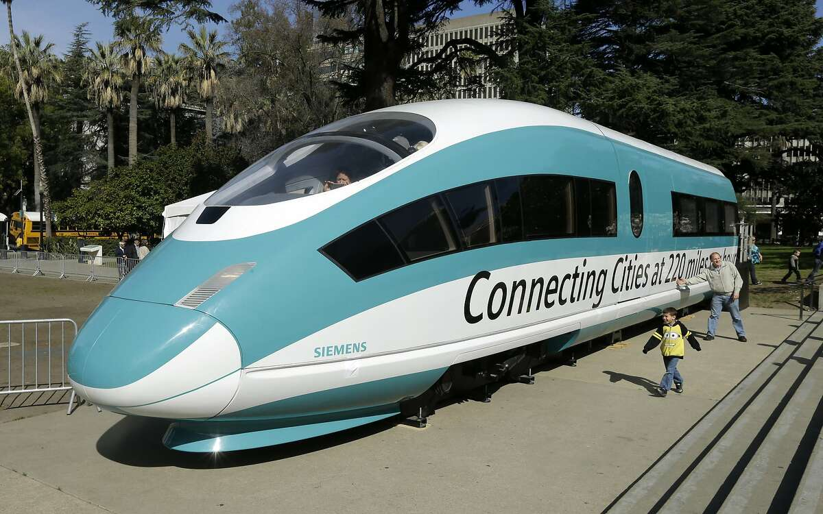 FILE - This Feb. 26, 2015, photo shows a full-scale mockup of a high-speed train, displayed at the Capitol in Sacramento, Calif. State rail officials issued an update to the high-speed train, Wednesday, May 1, 2019, with an estimated $18.3 billion price tag to complete 171 miles of track in the Central Valley by 2028.(AP Photo/Rich Pedroncelli, File)