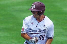 Texas A&M's Jonathan Ducoff reacts after hitting a three run homer during the eighth inning of the Southeastern Conference tournament NCAA college baseball game against Florida, Tuesday, May 21, 2019, in Birmingham, Ala. (AP Photo/Butch Dill)