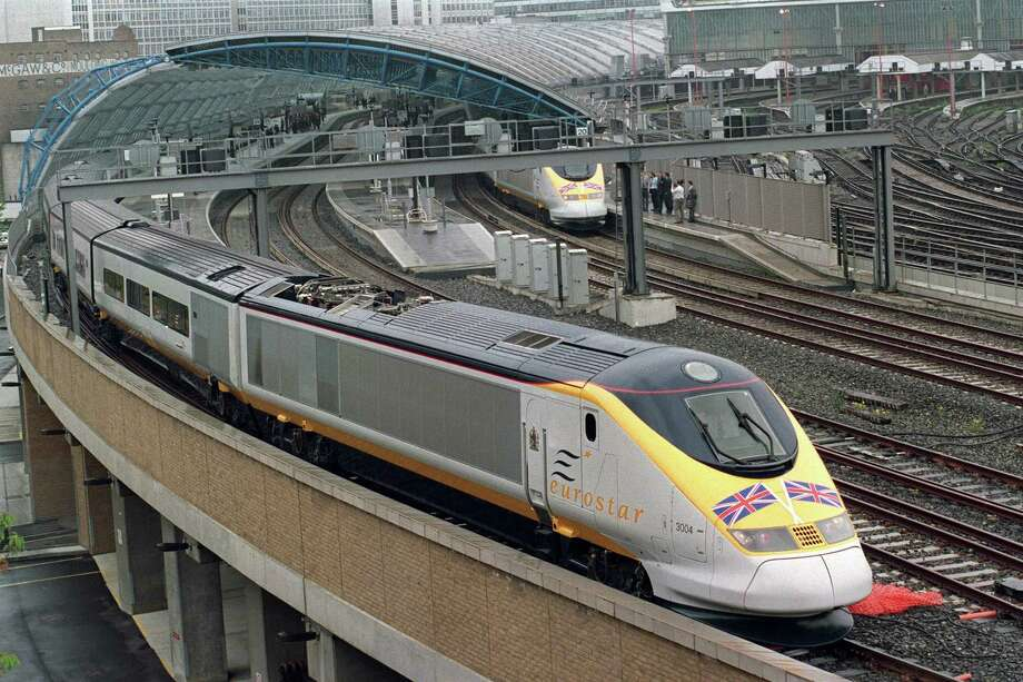 In this file photograph taken on May 6, 1994, a Eurostar Channel tunnel train - on its Royal Inaugural Journey to Paris with Queen Elizabeth and the Duke of Edinburgh onboard - pulls out of the international terminal at Waterloo Station in London. Photo: Andrew Winning / Getty Images / AFP or licensors