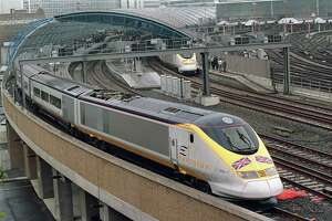In this file photograph taken on May 6, 1994, a Eurostar Channel tunnel train - on its Royal Inaugural Journey to Paris with Queen Elizabeth and the Duke of Edinburgh onboard - pulls out of the international terminal at Waterloo Station in London.