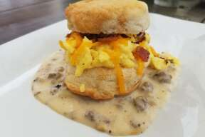 A bacon, egg and cheese biscuit with white sausage gravy at Alamo Biscuit Co.
