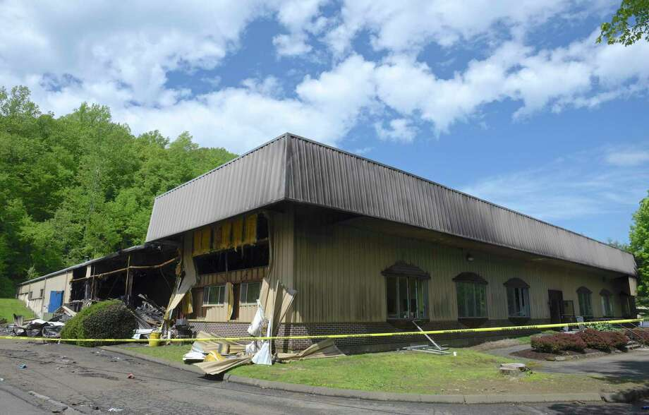 A building at 21 Francis J. Clarke Circle was damaged in a fire on Sunday. The building in Francis J. Clarke Industrial Park is home to Intersurface Dynamics and ATP, an adhesive tape company. Monday, May 20, 2019, in Bethel, Conn. Photo: H John Voorhees III / Hearst Connecticut Media / The News-Times