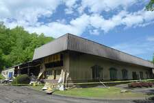 A building at 21 Francis J. Clarke Circle was damaged in a fire on Sunday. The building in Francis J. Clarke Industrial Park is home to Intersurface Dynamics and ATP, an adhesive tape company. Monday, May 20, 2019, in Bethel, Conn.