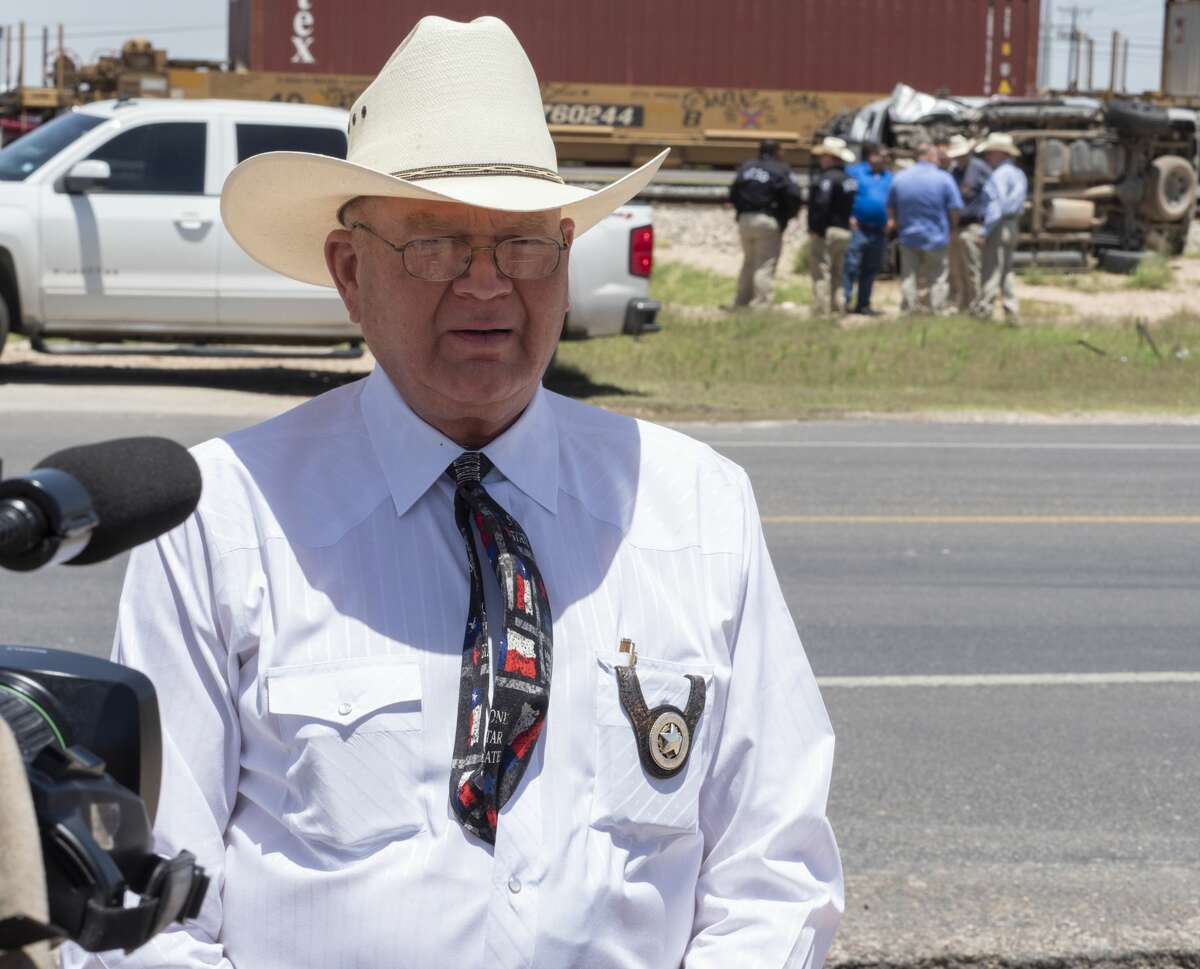Midland Sheriff Gary Painter speaks to the media after a Midland County Sheriff Deputy was injured 05/21/19 morning in a one vehicle accident with an eastbound train at the CR 1250 crossing. The deputy was responding to a call when he failed to yield to a passing train. Tim Fischer/Reporter-Telegram