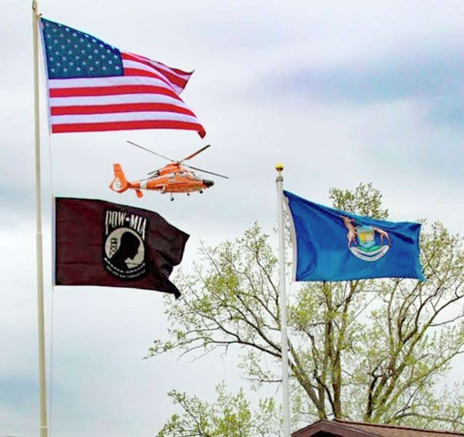 As part of the ceremony, the U.S. Coast Guard did a flyover at the dedication of the veteran memorial Saturday in Sebewaing. (Mary Drier/For the Tribune)