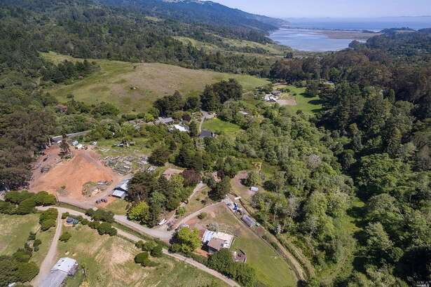 A 15-acre piece of property in Dogtown, Calif., with three single-family homes, artist studios and a vast expanse of untouched wilderness is listed for $4.8 million.