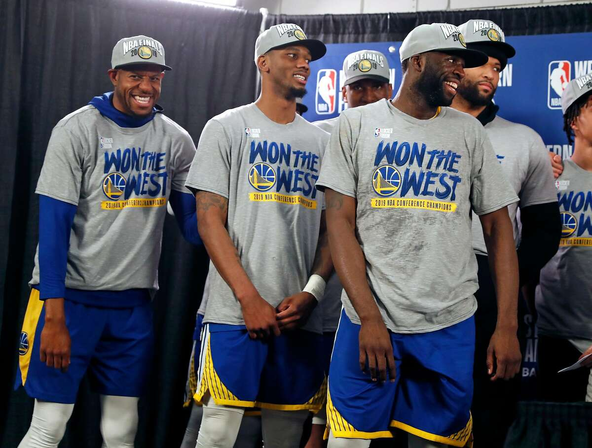 Golden State Warriors' Andre Iguodala, Alfonzo McKinnie and Draymond Green after 119-117 overtime win over Portland Trail Blazers' in NBA Western Conference Finals' Game 4 at Moda Center in Portland, Oregon on Monday, May 20, 2019.