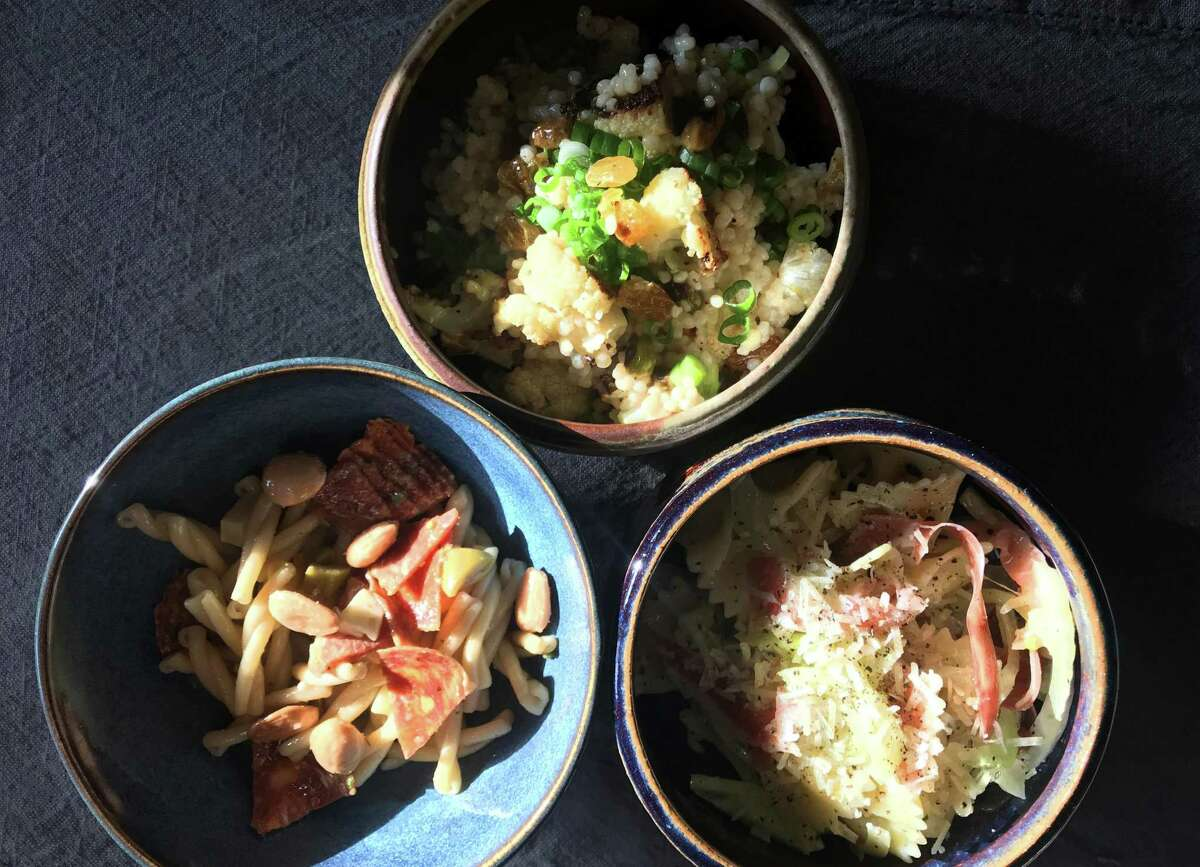 Clockwise from top: Moroccan Couscous Pasta Salad; Bow-Tie Pasta Salad with Fennel, Prosciutto and Parmesan; Tapas-Style Pasta Salad