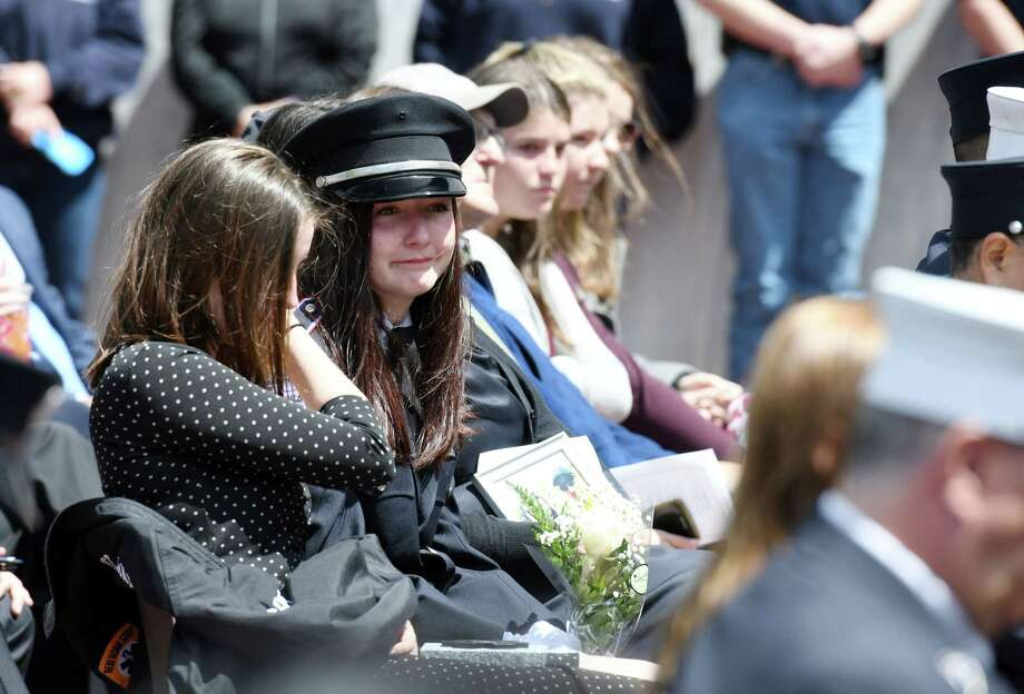 From left, Caroline Ryan, 17, and Michaela Ryan, 19, tear up after receiving a star of life in honor of their late father, William Ryan who served the Bay Community VAC, during a ceremony commemorating the lives of seven first responders on Tuesday, May 21, 2019 at the Empire State Plaza in Albany, NY. (Phoebe Sheehan/Times Union) Photo: Phoebe Sheehan, Albany Times Union / 20046991A