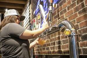Bartender Courtney Chambers pours a glass of Local 2731 during a beer tasting Saturday, May 18, 2019 at Southern Star Brewing Company in Conroe.