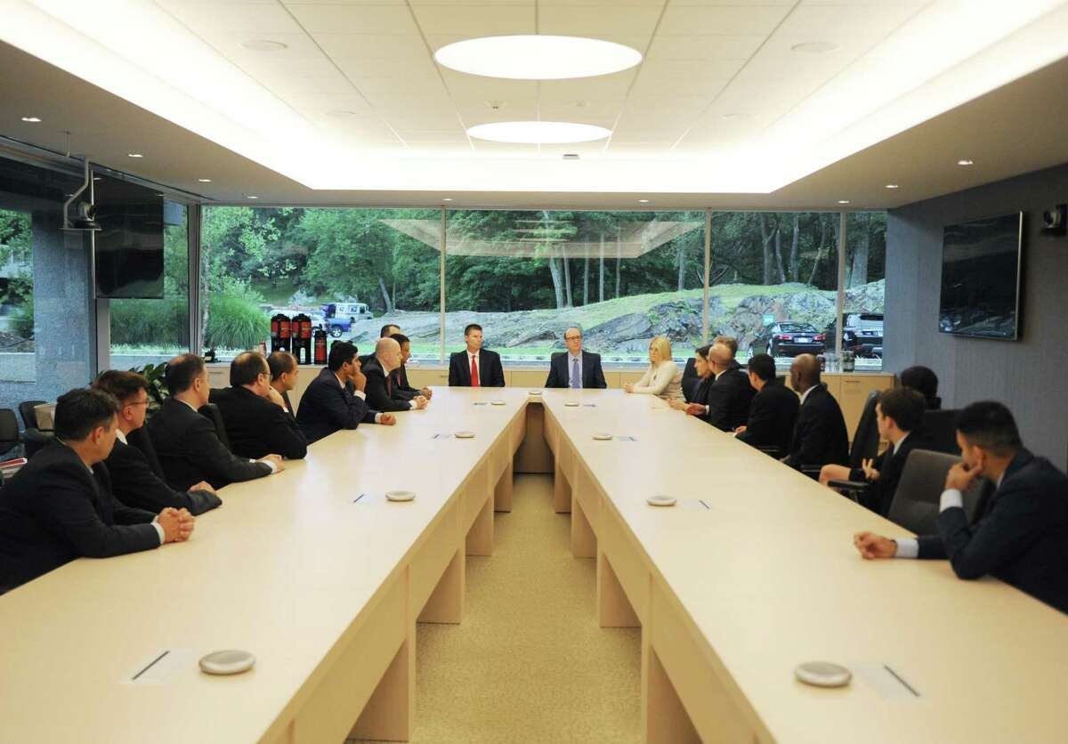 Sitting at the head of the table, XPO President Troy Cooper, left, and CEO Bradley Jacobs lead a meeting of XPO global leaders at the XPO Logistics headquarters in Greenwich, Conn., on July 25, 2017.
