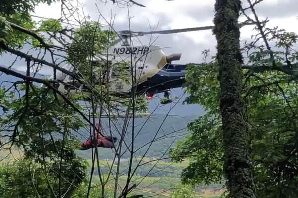 The California Highway Patrol conducted a hoist rescue after a woman's car flew 450 feet off a cliff in Napa County on Tuesday, May 21, 2019.