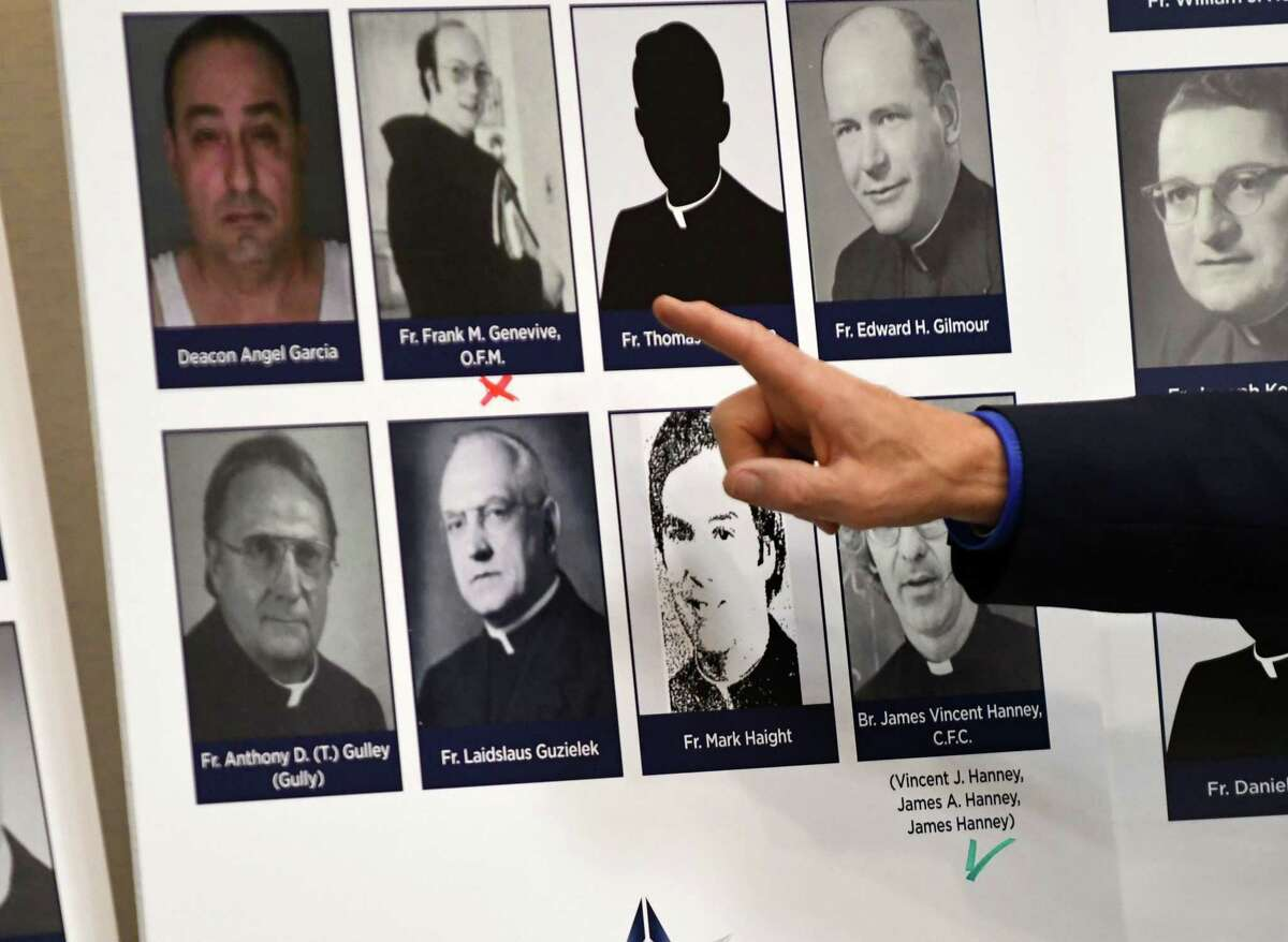 Attorney Jeff Anderson of Jeff Anderson & Associates, points to a page of accused clerics from the Diocese of Albany on Tuesday, May 21, 2019, during a press conference in Albany, N.Y. The law firm plans to represent plaintiffs once the state's Child Victims Act goes into effect in August. (Will Waldron/Times Union)
