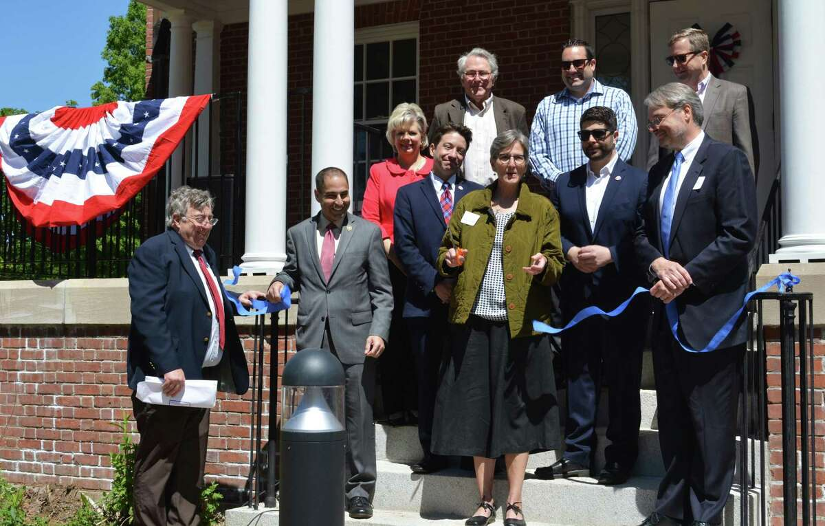 Dignitaries, community stakeholders and other officials gathered Tuesday morning for a ribbon cutting for the Columbus House's Shepherd Home at 112 Bow Lane, Middletown. The facility, on the Connecticut Valley Hospital campus and formerly owned by the state of Connecticut, will house 32 veterans, who are homeless or at risk of being so, placing them in permanent housing with supportive services.