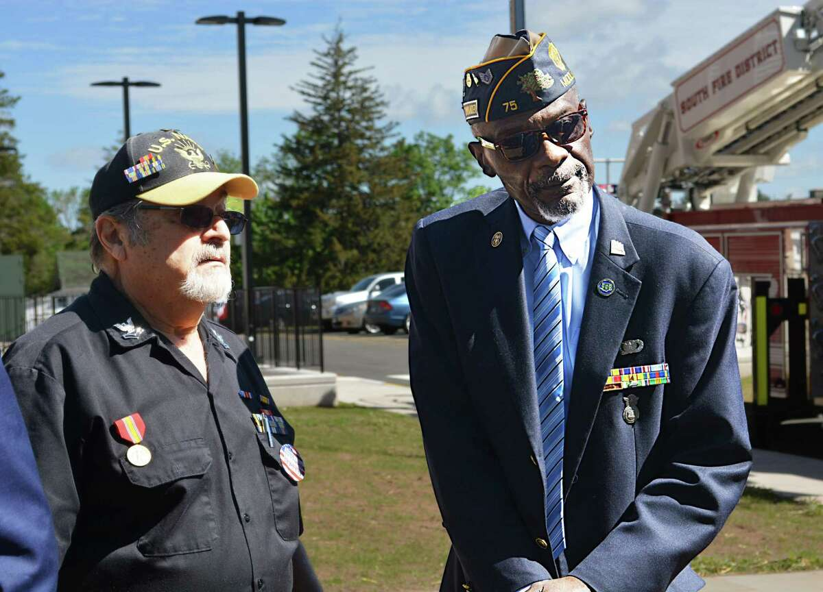 Middletown's American Legion Post 75 Commander Larry Riley, right, attends the Columbus House Shepherd Home grand opening at 112 Bow Lane Tuesday morning.