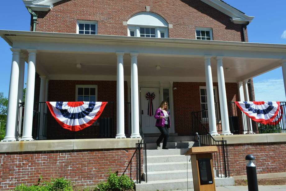 State and local dignitaries, as well as community stakeholders and other officials gathered in June during a ribbon cutting for the Columbus House's Shepherd Home at 112 Bow Lane, Middletown. Photo: Cassandra Day / Hearst Connecticut Media