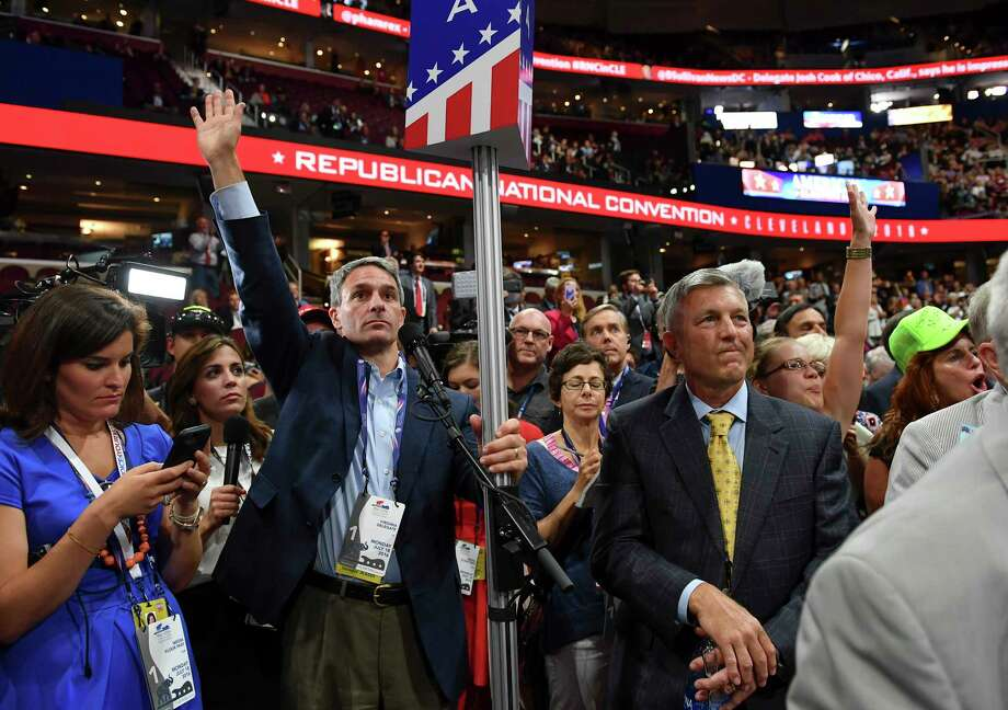 Former Virginia Attorney General, Ken Cuccinelli, center, demands a roll-call vote on the convention rules during the Republican National Convention on July 18, 2016 in Cleveland. He is set to join the Trump administration in an immigration role this week. Photo: Washington Post Photo By Ricky Carioti. / The Washington Post