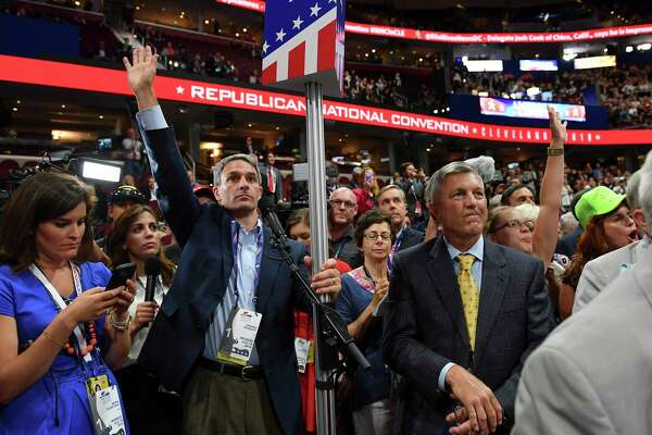 Former Virginia Attorney General, Ken Cuccinelli, center, demands a roll-call vote on the convention rules during the Republican National Convention on July 18, 2016 in Cleveland. He is set to join the Trump administration in an immigration role this week.