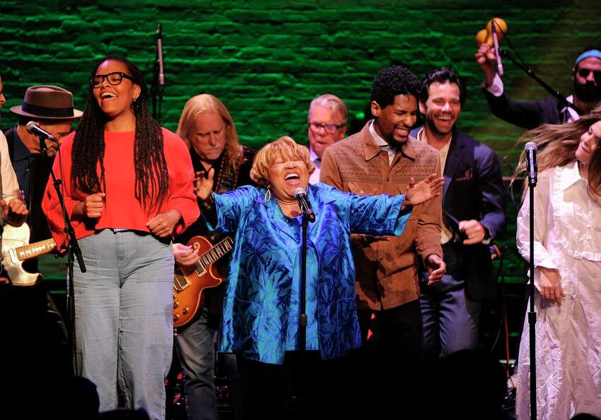 Singer Mavis Staples, center, performs at the Apollo Theater to celebrate the release of her new album