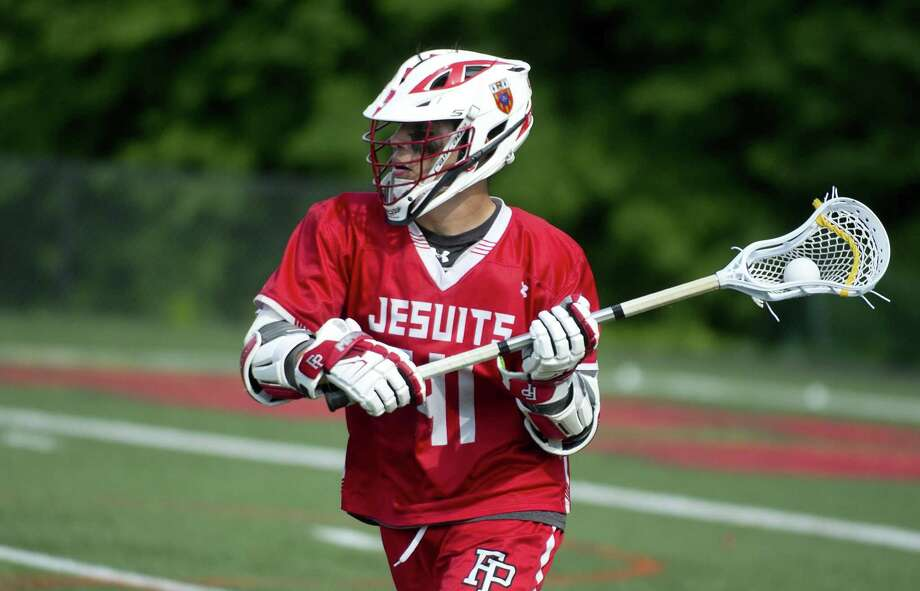 Fairfield Prep's Ethan Grandolfo controls the ball during Saturday's Class L boys lacrosse quarterfinal game at New Canaan High School on June 2, 2018. Photo: Lindsay Perry / For Hearst Connecticut Media / Stamford Advocate Freelance