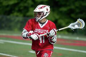 Fairfield Prep's Ethan Grandolfo controls the ball during Saturday's Class L boys lacrosse quarterfinal game at New Canaan High School on June 2, 2018.