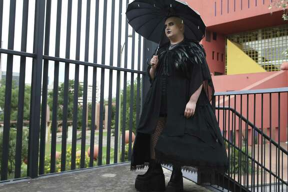 "Mason Rhodes models his costume, titled ""Death in Drag."""