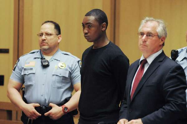"""Andre Quinn Russell, 20, of Ludlow St., is arraigned at the Stamford courthouse Friday, June 13, 2014 charged with murder of William """"Buttons"""" James."""