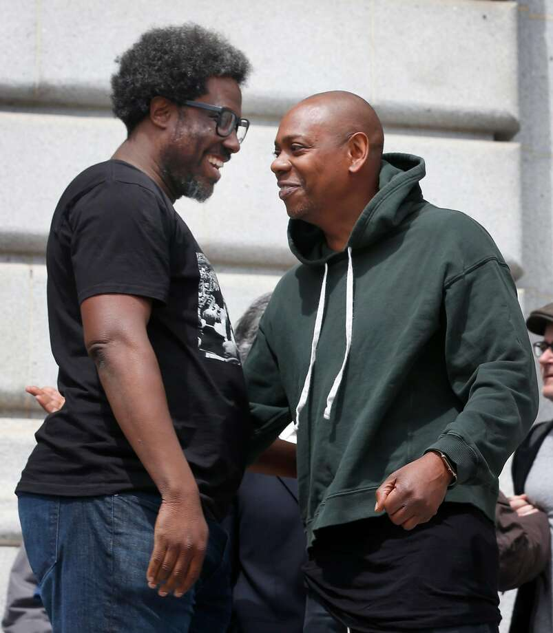Comedians W. Kamau Bell and Dave Chappelle appear at a rally at City Hall to announce an effort by Supervisor Aaron Peskin to prevent the Punch Line comedy club from shutting down in San Francisco, Calif. on Tuesday, May 21, 2019. Photo: Paul Chinn, The Chronicle
