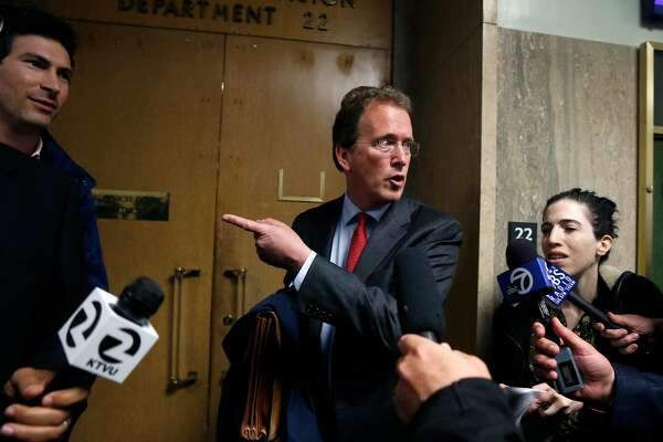 Thomas R. Burke, an attorney representing freelance videographer Bryan Carmody, leaves Department 22 after a hearing at the Hall of Justice in San Francisco, Calif. on Tuesday, May 21, 2019 to hear arguments in a motion filed to quash a search warrant and seizure of equipment from Carmody. Police officers obtained the warrant to search Carmody's home after he sold a leaked confidential police report on the death of public defender Jeff Adachi to television news outlets.