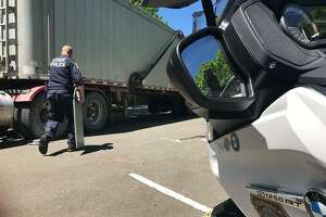 Photos provided by police of officers involved in the recent commercial motor vehicle inspections in Norwalk, Conn.