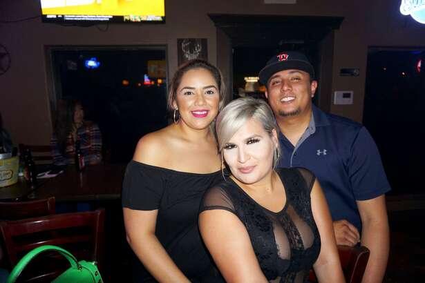 Yedid Torres, Delia Denise and Javier Cantu at Blue Moon Country Bar & Patio