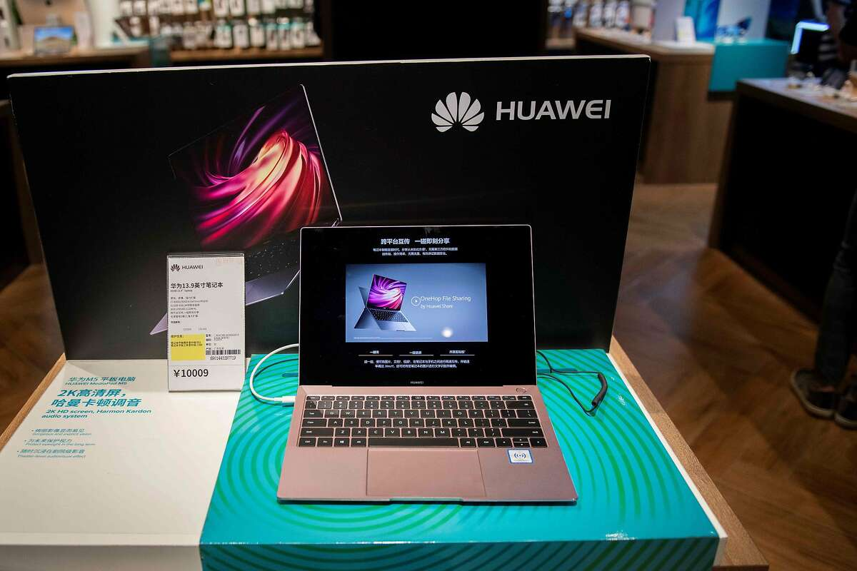 A Huawei computer is displayed in a retail store in Beijing. The company is facing U.S. sanctions.