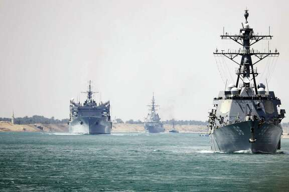 The aircraft carrier Abraham Lincoln and support vessels pass through the Suez Canal on May 9, en route to the Persian Gulf after reports that four vessels were attacked at the mouth of the Persian Gulf.