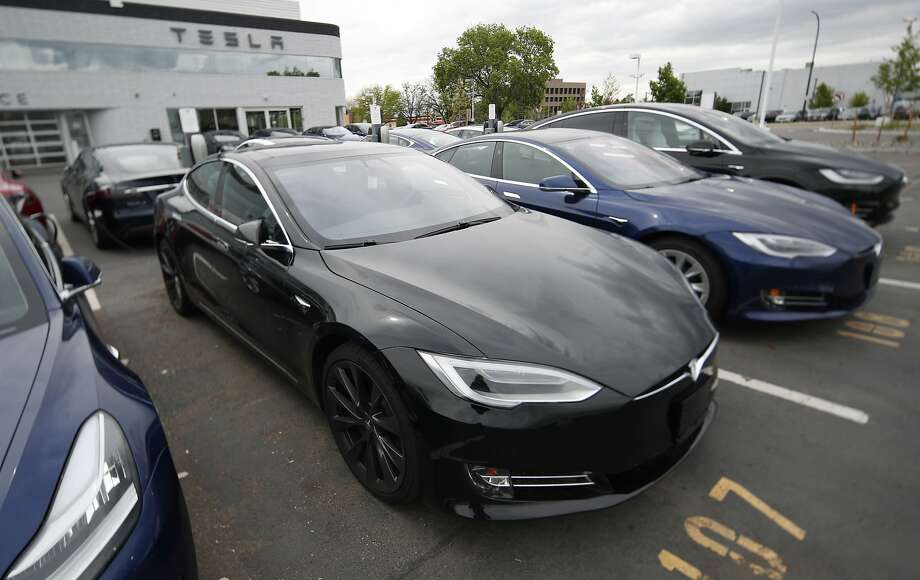 FILE--In this Sunday, May 19, 2019, file photograph, a line of unsold 2019 Model S sedans sits at a Tesla dealership in Littleton, Colo. (AP Photo/David Zalubowski) Photo: David Zalubowski / Associated Press