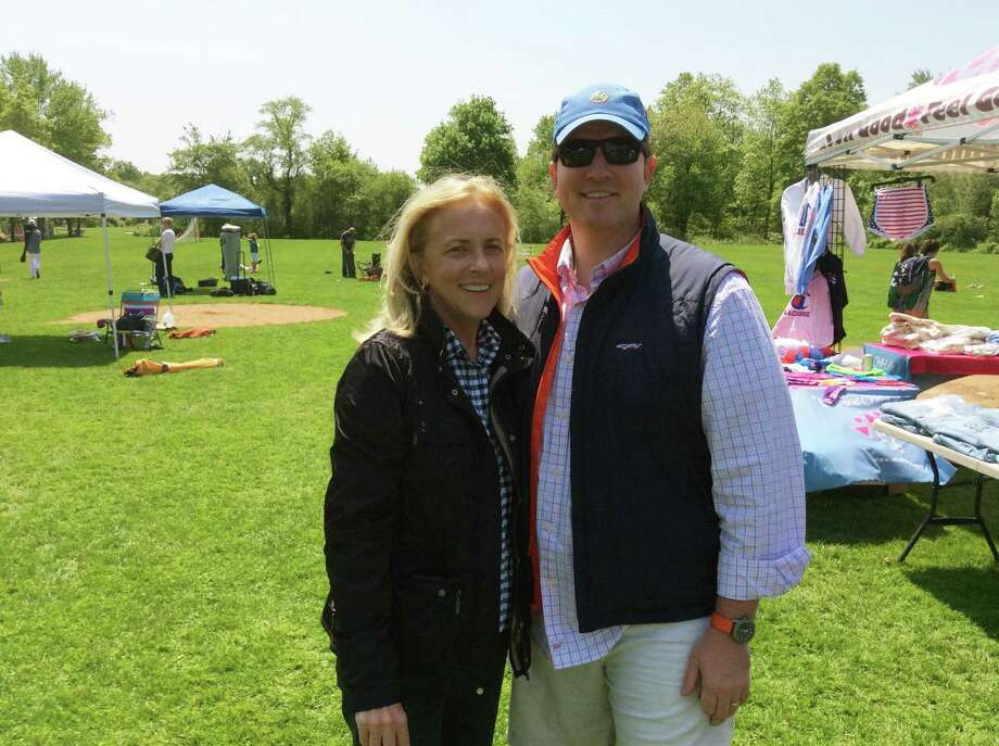 Tricia Higgins O'Callaghan, left and her son Tim Higgins, gather at the Katie Cassidy Higgins Memorial Lacrosse Tournament held at Sacred Heart Greenwich on Sunday, May 19, 2019. The event benefited Higgins O'Callaghan's beloved late daughter Katie Cassidy Higgins. Photo: David Fierro / Hearst Connecticut Media / Connecticut Post
